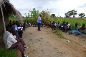 Working in a team of two, paralegals from PASI East conduct a sensitisation meeting
