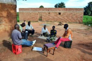 PASI paralegals conducting interviews with family members near Mzuzu