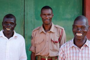 John Chikayiku Nthara Banda [left] and Jamu Kalipentala Banda [right], with Malawi  Prison  Service  Officer  Andrew  Dzinyemba.  John  and  Jamu  were released  after  20  years.  The  judge  considered  witness  statements  collected by the state and the defence which showed that the men had been trying to assist the victim