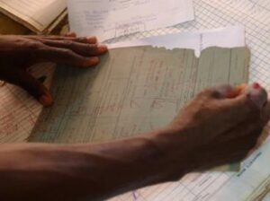 Zomba, February 2015 –a prison officer marks the prison record of a man released after a sentence rehearing where the court considered evidence gathered by paralegals
